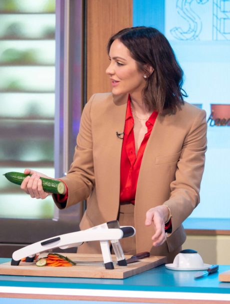 Katharine McPhee holds a cucumber at the Sunday Brunch Show in London, 2019
