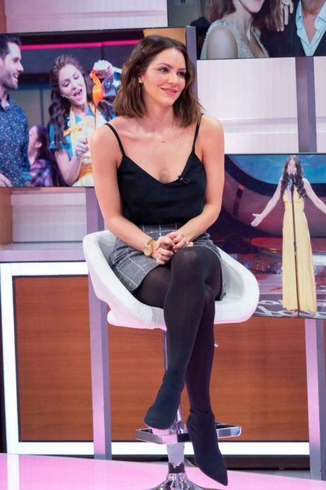 Katharine McPhee sits on white chair