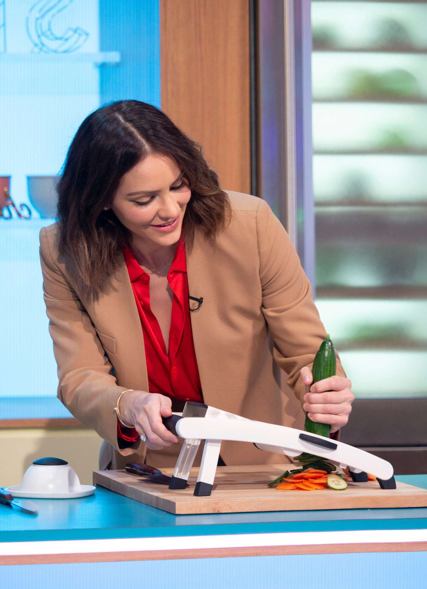 Katharine McPhee slisec a cucumber at the Sunday Brunch Show in London, 2019