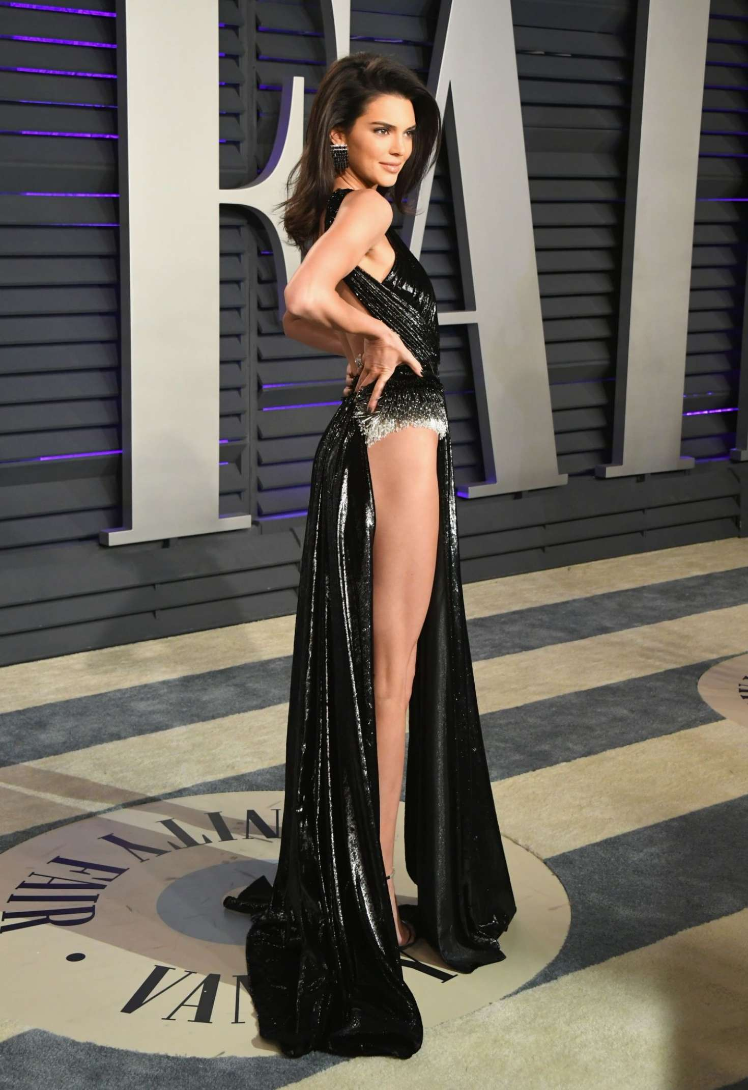 Kendall Jenner in dress with cut on full leg at Vanity Fair Oscar Party in Beverly Hills, 2019