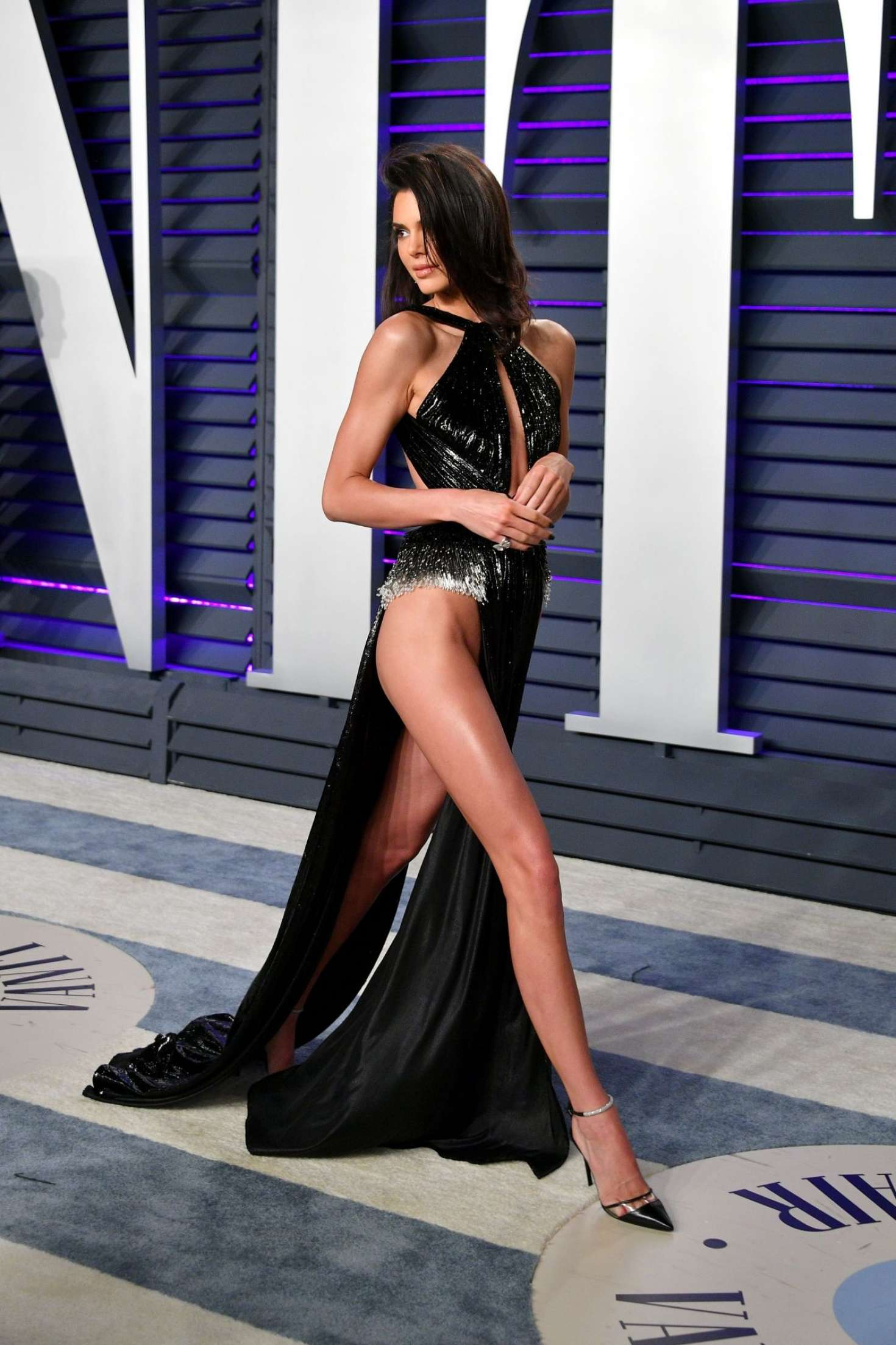 Kendall Jenner in opened black dress at Vanity Fair Oscar Party in Beverly Hills, 2019
