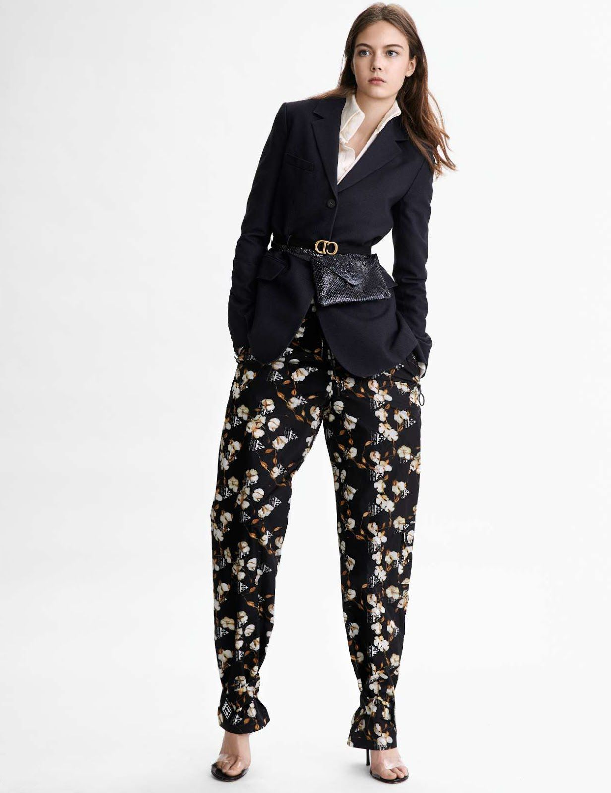 Laura Turka in black blazer and flowered pants
