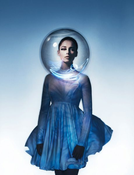 Naomi Scott in blue dress with transparent ball in her head