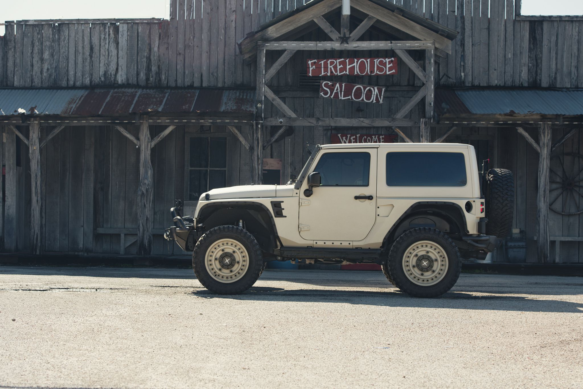 Spanish White Jeep Wrangler JK near FireHouse Saloon