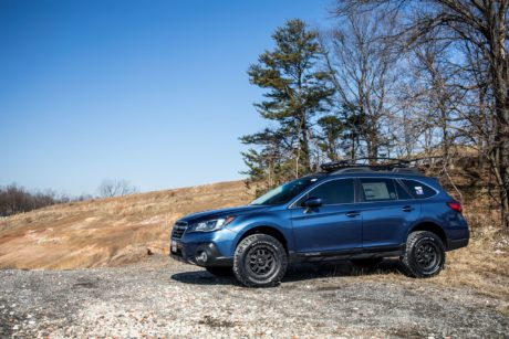 Subaru Outback on black wheels