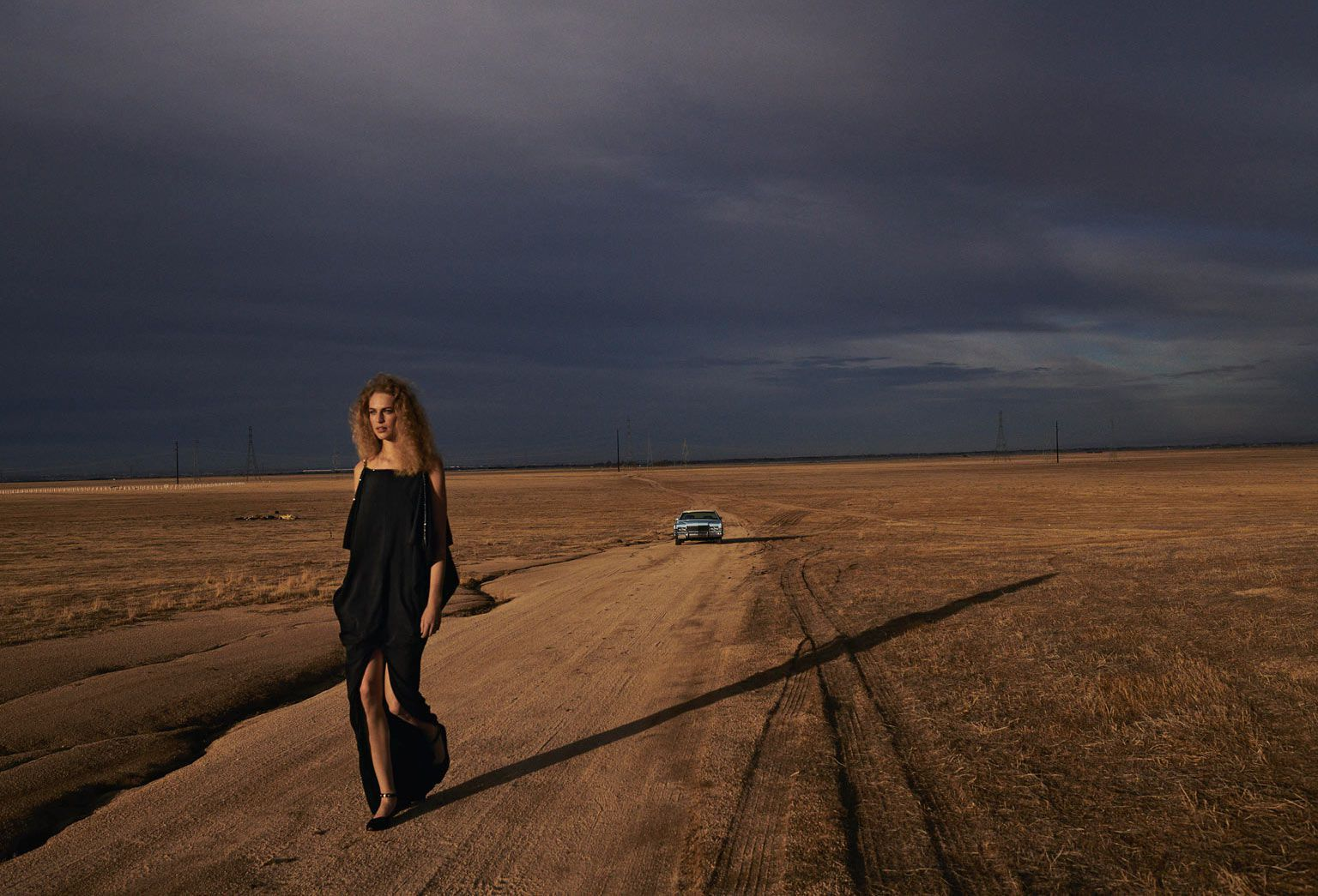 Vanessa Axente in black dress, cloudy day