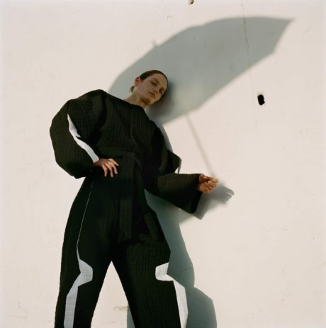Viven Solari in black with shadow of umbrella