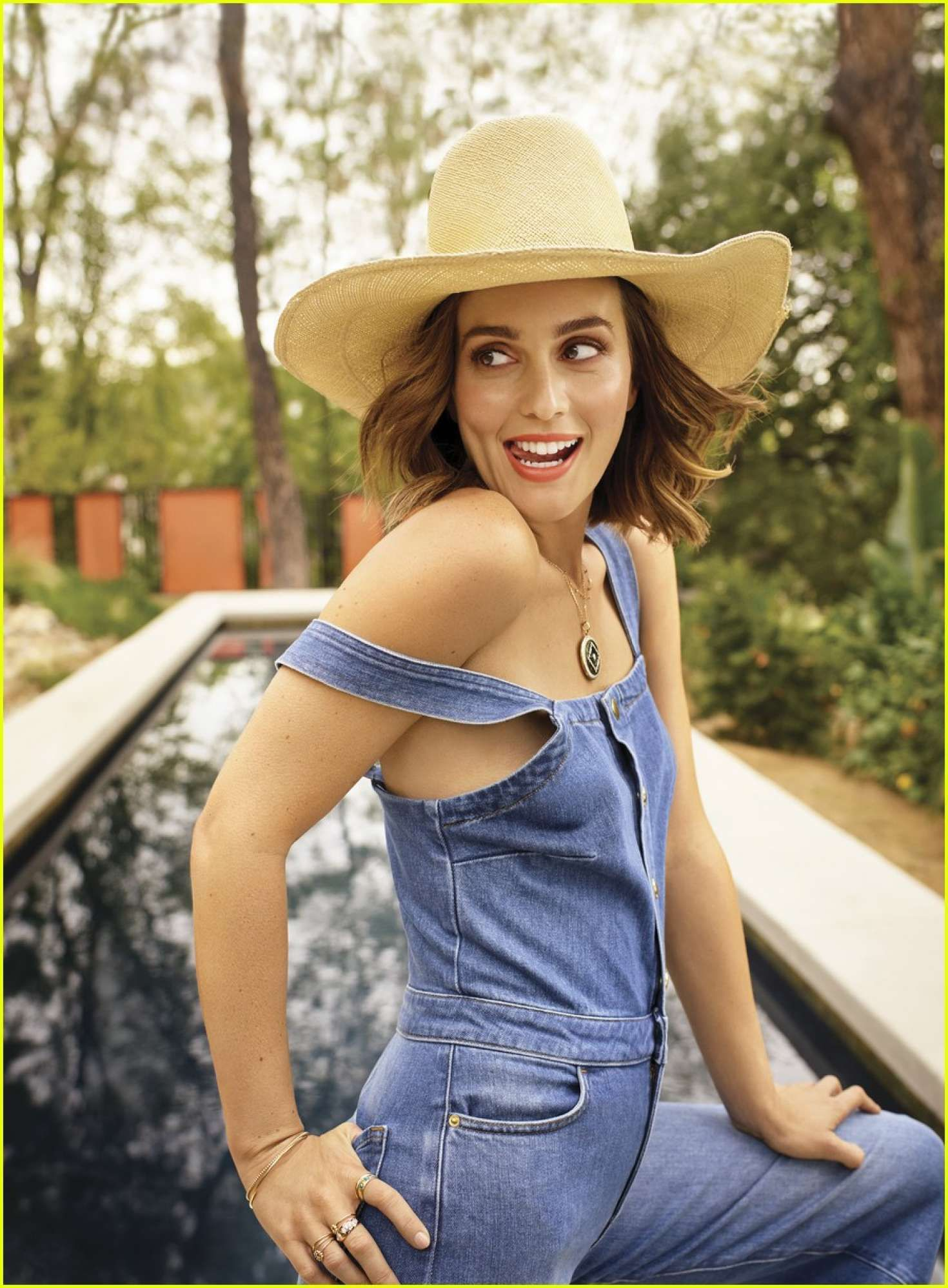 happy Leighton Meester in large hat