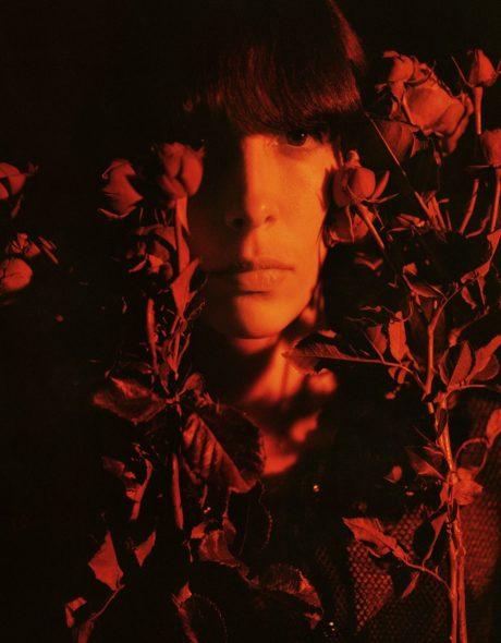 red roses at Jamie Bochert face background