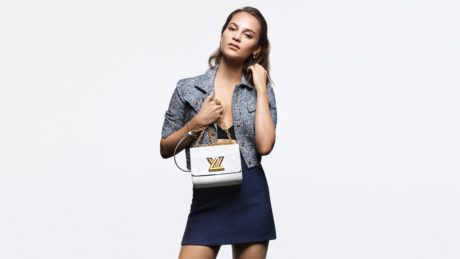 Alicia Vikander with new white bag by Louis Vuitton