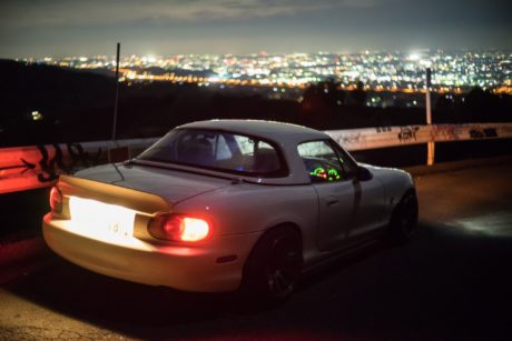 Mazda Miata at city background
