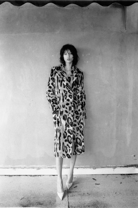 Yasmin Wijnaldum in long coat with leopard print
